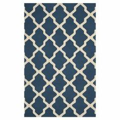"""Stylishly anchor your living room or master suite with this elegant hand-tufted wool rug, showcasing a classic quatrefoil trellis motif in navy blue and ivory.  Product: RugConstruction Material: WoolColor: Navy blue and ivoryFeatures:  Hand-tuftedQuatrefoil trellis motifMade in India Pile Height: 0.63"""" Note: Please be aware that actual colors may vary from those shown on your screen. Accent rugs may also not show the entire pattern that the corresponding area rugs have.Cleaning and Care…"""