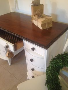 Deouble pedestal desk with braided edge. Chocolate polka dot papered drawers.