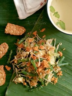 Urap-urap sayur, cooked vegetables with spiced grated coconut. - (This recipe says to steam in banana leaves. However, I'm pinning this for the coconut mixture part, which I will then use to mix with cooked green or long beans, etc. The recipe also shows a picture using edamame.)