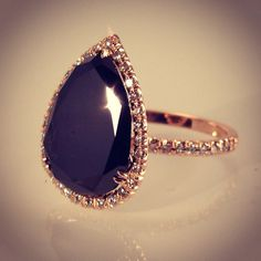 Bespoke Pear shaped black diamond with white diamonds in rose gold