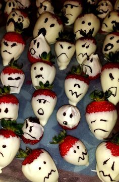 """Great idea for a """"healthier"""" Halloween school party - Strawberry """"Ghosts"""" instead of cupcakes and cookies.   Recipe is simple -  you'll need: strawberries, white chocolate chips, dark chocolate chips and almond extract.   Melt the white chocolate, add about 1/2 tsp of almond extract. Stir. Dip strawberries and rest on wax paper. Melt dark chocolate, stir. Use a toothpick to draw """"scary"""" faces.   To make an even healthier version, dip strawberries in vanilla yogurt and freeze!   Happy…"""