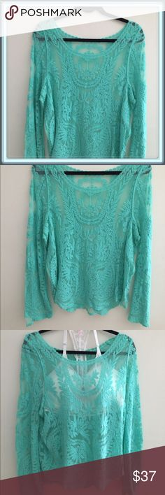 Fabulous Tiffany Blue sheer crochet top Beautiful sheer top with gorgeous detail. I took a picture with a Bralette so you can see what it will look like.  The size is small.  Also the top has never been worn! Tops