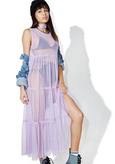 The Ragged Priest Romance Dress wants to woo you over, bb. This beautiful maxi dress features a lilac hue sheer construction with paneled frilly tiers and a raw hem.