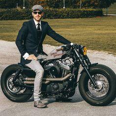 Dapper gentleman rider on Harley Davidson sportster motorcycle bike.