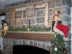 check out her mantel, rusted tin panel!