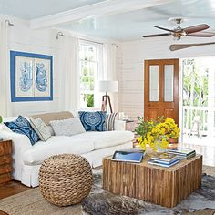 Colorful Key West Cottage Living Room. I love that coffee table!!