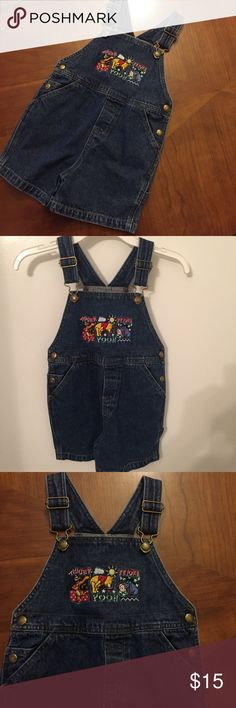 Disney store Winnie the Pooh  short overalls 3T Disney Store never worn Winnie the Pooh , Tigger and Eeyore  short Jean overalls size 3T. Boy or girl could wear . Disney Bottoms Overalls