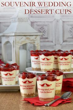 Simple cold desserts presented in plastic cups personalized with a wedding design and message from the bride and groom make tasty treats with a unique, personal twist to add color and originality to a reception dessert table. These cherry cheesecake desserts in 8 ounce cups were easy to make and so attractive with matching red personalization. The 8 Oz. personalized plastic cups can be ordered at http://myweddingreceptionideas.com/5_oz_personalized_clear_plastic_tumblers_cups.asp