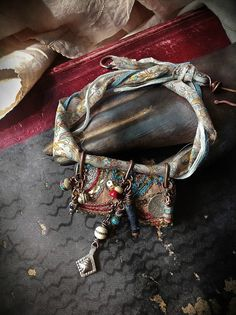 Gypsy amulet necklace: vintage embroidered textiles with kuchi and bead charms in blue, gold and red