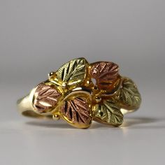A personal favorite from my Etsy shop https://www.etsy.com/listing/257711156/black-hills-gold-ring-tri-color-gold