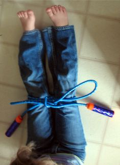 Use a jump rope to teach tying shoe laces...it's bigger, so it's easier to grasp the concept (gross motor supports fine motor).