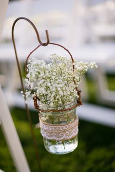Baby's Breath Wedding Ceremony Aisle Marker | Michael Anthony Photography | See more: www.weddingwire.com