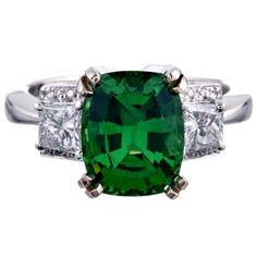 3.82ct Tsavorite Garnet and Trapezoid Diamond Three-Stone Ring   (1stdibs.com)