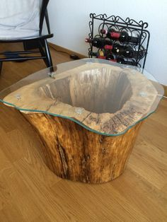 i made this coffee table with a lamp inside out of an old hollowed out tree