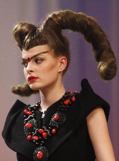 This lucky model Hulga, sports a bighorn sheep hairstyle as she presents a creation by Ukrainian designer Julia Aysina during Ukrainian Fashion Week in Kiev March 20, 2011.
