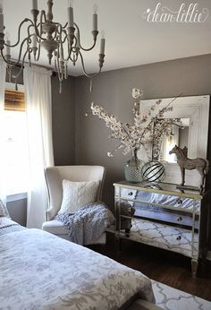 Master bedroom.  Dark taupe walls, light, airy decor.  Will look nice with warm wood floors and furniture.