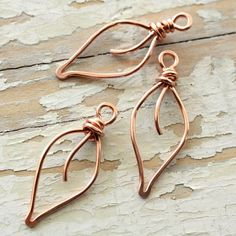Small leaves handformed from 18g solid copper wire and hammered for strength. I form each leaf individually using hand tools. The wire is bare and not lacquered. Size: approx. 30-32mm long ~~~~~ These are made to order. Some variation in shape and size, as well as tool marks, are to be