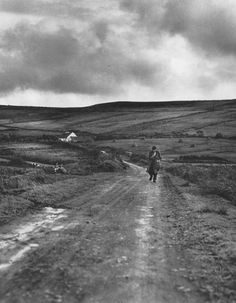 Country Road, County Clare, Ireland - Dorothea Lange interesting image, lots of shades dark, light gloomy. looks like a war type of setting. Vivian Maier, Documentary Photographers, Famous Photographers, Great Photos, Old Photos, Dorothea Lange Photography, Images Of Ireland, Ireland Pictures, Social Realism