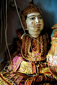 Burmese puppets are large wooden carved marionettes with glass eyes