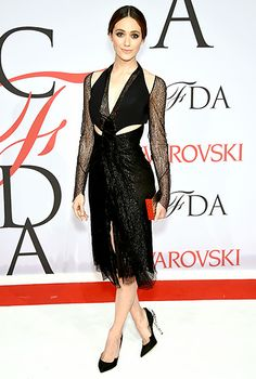 Emmy Rossum toyed with her dark side in a black, long-sleeved, lace dress by Dion Lee and pumps with see-through heels.