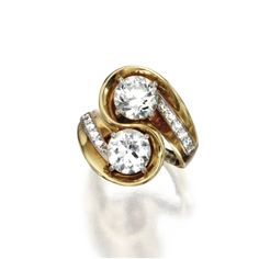 GOLD, PLATINUM AND DIAMOND RING Of crossover design set with old European-cut diamonds weighing approximately 2.00 and 1.85 carats, flanked by small round diamonds weighing approximately .35 carat