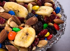 An addictive combination of roasted nuts, dried fruit, and chocolate makes this the perfect snack to throw together before you hit the trail or the road.      This recipe was featured as part of our ...