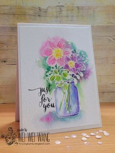 Heat emboss in white on watercolour paper. Spray with water and colour. (Flowers added to masked vase.)