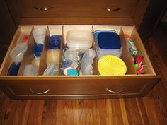 I also have a container drawer - love having the plastic in drawers so no more avalanches!!
