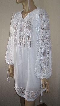 Fabulous hand embroidered Romanian blouse dress ! The embroiderer turns the fabric into lace . This is a Romanian masterpiece , not only a dress !!