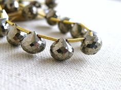 Pyrite Onion Briolette Faceted AAA Golden by somsstudiosupplies, $22.00