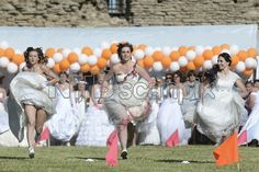 About 70 women from Estonia, Russia and Latvia dressed as a brides compete in 50m run for diamand ring Grand Prix at medieval castle of Narva, Third largest city of Estonia on June 4, 2016 during the International Runaway Bride competiton. (Xinhua/Sergei Stepanov)