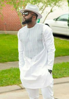 Item Overview • Handmade item • Style: Shirt and Pants • Material: Cotton, Polished Cotton, Linen • Ships worldwide from Boston Item Details African Men Suit 2side pockets (optional) Embroidery ( depends on style) WE ALSO PROVIDE WHOLESALE PRICES FOR EVENTS(ORDERS OF 5 OR MORE)