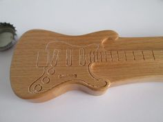 Handmade wooden Bottle Opener in the shape of an Stratocaster guitar. The body wood is Alder. The screws are made out of metal. Size approx. 6 1/2 inch long x 1 3/4 inch wide x 3/4 inch thick.