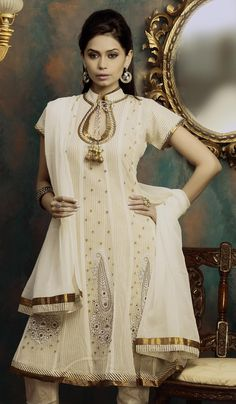 Shalwar kameez; this neckline is lovely, not too high and not too low.