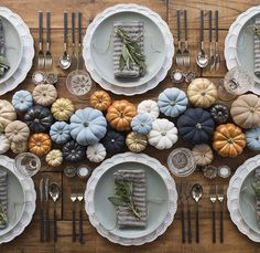 Colorfull pumpkins displayed on a rustic table