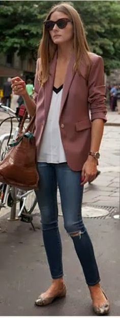 Olivia Palermo in Paris - cute drapey shirt with distressed skinnies.