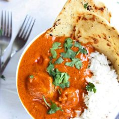 Indian Butter Chicken Recipe Main Dishes with butter, chicken breasts, yellow onion, garlic cloves, garam masala, ginger, chili powder, ground cumin, cayenne pepper, tomato sauce, cream, pepper, salt, cilantro, lime, rice, naan