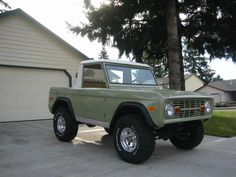 Little Moss Green Bronco with White Hard Top...Simple and Sweet....A great vehicle for the lake house