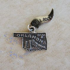 Oklahoma State Map Travel Sterling Silver Bracelet Charm Will Rogers Flag by Charmcrazey on Etsy https://www.etsy.com/listing/228800329/oklahoma-state-map-travel-sterling