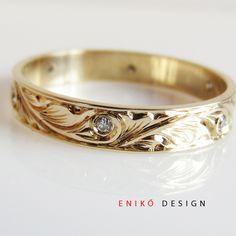 Love this wedding band.  Diamond swirl engrave detailed Wedding band 14k yellow gold. Etsy jeweler.