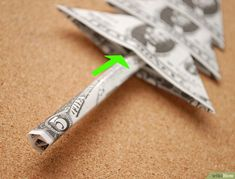 3 Ways to Fold Money for a Money Tree - wikiHow