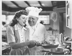 """1945's """"Christmas in Connecticut."""" Photo of Barbara Stanwyck and S.Z. """"Cuddles"""" Sakall from t5he L.A. times files."""