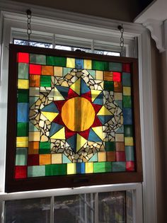 Quilt mosaic on old window.