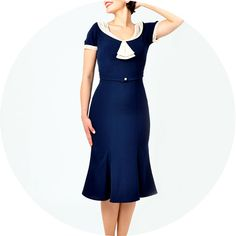 Some kind of stretch fabric. For hourglass figure .ALady The Janet Dress - Navy with cream lace UK seller.