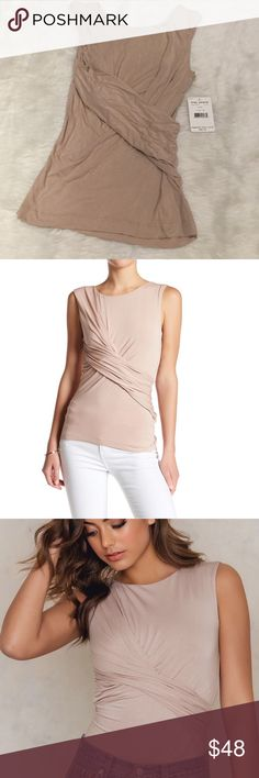 NWT Free People Love Me Tank Super stretchy tank with a chic, modern feel.  Front features a crossed rouched detail, creating a perfectly wrapped look.  Rayon/spandex blend.  Color: Nude. Free People Tops Tank Tops
