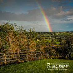 www.jamesatruett.com - A evening rainbow arcs across the emerald green countryside of County Clare, #Ireland,  near Lissycasey.