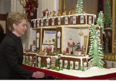 "Here, U.S. First Lady Hillary Clinton admires the gingerbread house on Display in the East Room of the White House on December 4, 2000. The White House was decorated with ornaments, wreaths, mantlepieces and gingerbread masterpieces each reflecting the theme of ""Holiday Reflections"" chosen by the Clinton's. A"