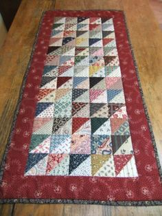 This colorful quilted table runner is very warm and inviting. It will be sure to make an eye-catching display no matter where you use it. It would look great on any table, on the back of a chair, on a quilt rack or folded and tucked in cupboard or basket. . Endless ideas!! The