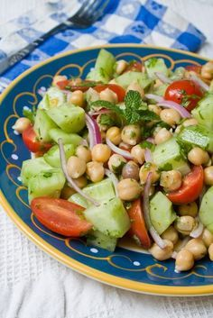 Chick Pea Salad-Chickpea Veggie Salad  Serves 2 as a main, or 4 as a side    1 can chickpeas  1 English cucumber, chopped (seeded if necessary)  1 ½ cups halved grape tomatoes  3 tablespoons thinly sliced red onion  2 tablespoons chopped fresh cilantro  1 tablespoon chopped mint (optional)  1 tablespoon lemon juice  ½ tablespoon apple cider vinegar  3 tablespoons good olive oil  salt and pepper