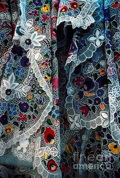 Closeup of lace and embroidery tablecloths for sale at a shop in Hungary. Typical style from the town of Kalocsa in the Plains. Click image to purchase print.